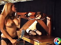 Mistress Maxine X places Jaden in the stockades spanking her ass till it turns a hot shade of pink