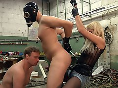 Two slaves getting sucked and fucked in the factory
