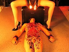 Wax play with slave in bondage