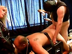 Strapon dominas and bisexual slave penetrate male slave`s ass with fingers, dick and strapons