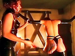 Mistress whips bondaged babe round ass